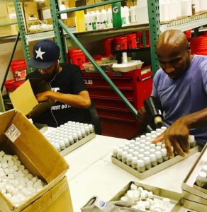 ALL HANDS ON…BOTTLES GET CAPPED AND SHRINK-WRAPPED